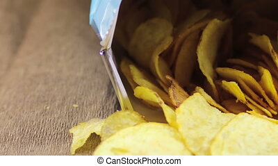 Potato Chips in Open Package on Table Rotating - Open...