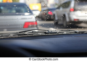 rain drops on windshield - picture of car interior with rain...
