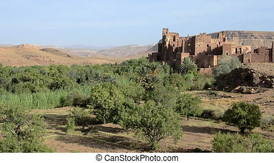 Ancient clay Tamedakhte city near Ouarzazate and Atlas...