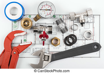 plumbing tools and equipment on blueprint