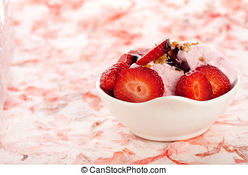Strawberry icecream with fresh strawberries on pink...