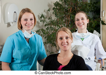Dental team and patient - Dental team and a patient ready to...