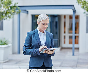 Available non stop - A young businesswoman working on her...