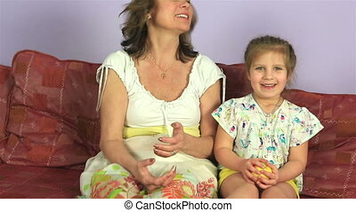 Happy joyful woman with little granddaughter eat delicious...