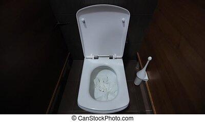 Flushing the toilet white mans hand