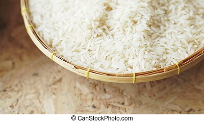 Organic dried rice in rattan bowl - Rice in a rattan bowl on...