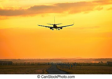 Airplane is landing - Silhouette of the airplane during...