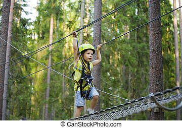 little cute boy in helmet runs track, leisure on nature...