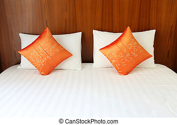 Bed, pillows in resort room
