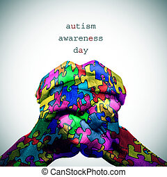 puzzle-patterned hands and text autism awareness day - text...