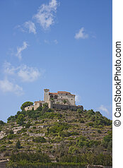 castle on hill in arta in majorca, spain