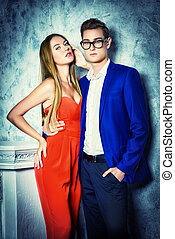 fashion models - Gorgeous couple of young people stand in a...