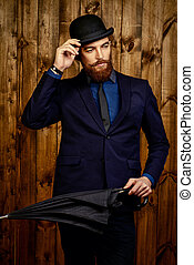 retro fashion - Elegant man with beard and mustache wearing...