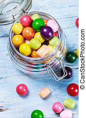 chewing gum and candies in jar