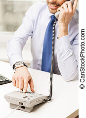 businessman dialing number and calling on phone