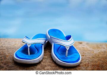 Blue Flip Flops Next to Swimming Pool