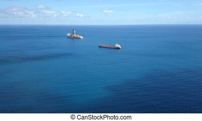 Cargo ships waiting outside of the port in Tenerife, Canary...