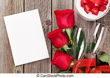 Valentines day greeting card, gift box and red roses