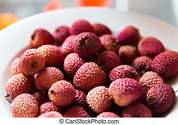 lychee on plate - food, fruits and eating concept - lychee...