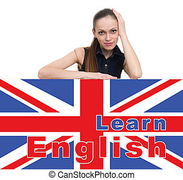 learning english concept. Attractive woman looking over top...