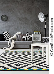 Monochromatic living room idea - Grey living room with sofa,...
