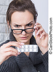 This pills can cause many side effects - Woman in glasses...