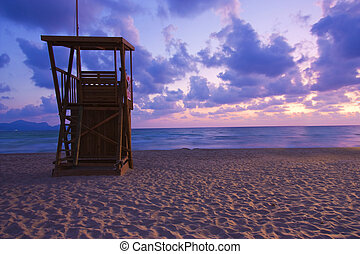 lifeguard hut at dawn at can picafort beach, majorca