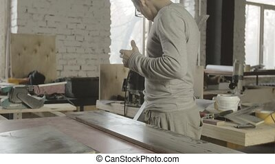 Professional carpenter measure wooden board on table. Process making furniture