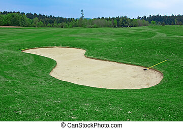 Sand trap on the green golf field
