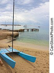 boat on beach - boat on empty beach in palma in majorca