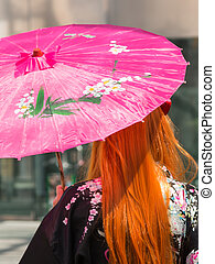 Red Hair Girl with Traditional Japanese Pink Wagasa Umbrella
