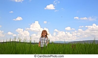 Cute Boy Jumping In Green Meadow