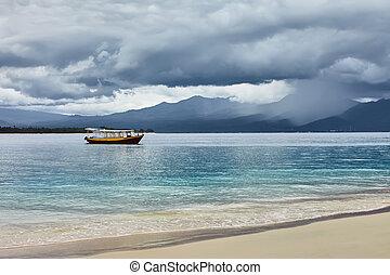 tropical beach on a rainy summer day