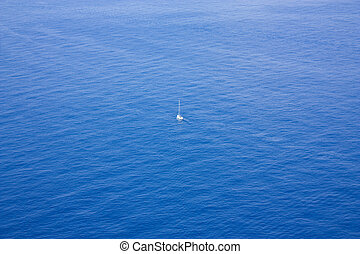 Single boat sailing in a vast ocean - Photo of Single boat...