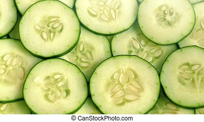 Juicy Cucumber Slices Rotating - Fresh cucumber slices...