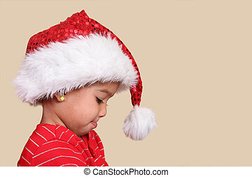 Mixed race girl  in a santa hat