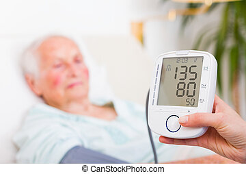Digital Measurer - Normal Blood Pressure - Nurse measuring a...
