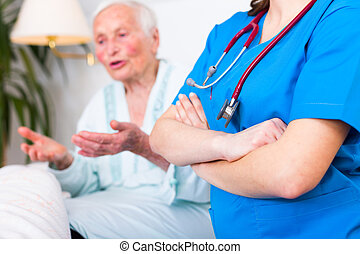 Nursing home care concept - Confident geriatric doctor with...