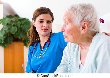 Nurse with great patience - Geriatric doctor listening to...
