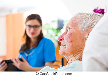 Relying On Home Caregiver - Sick elderly woman laying sad in...