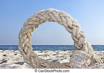 Ring of old rope on a seashore