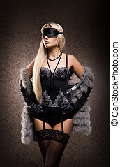 Lovely sexy lady in fur and lingerie on vintage background.