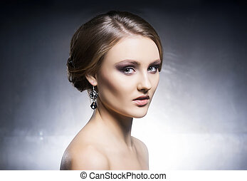 Portrait of beautiful girl in shiny jewels