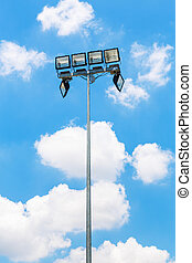 Floodlight tower on blue sky and white cloud