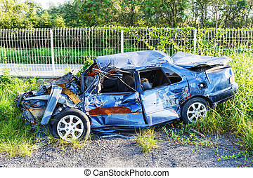 Car wreck - Old and rusty damaged car wreck in junk yard,...