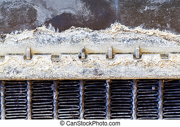 Leaky car radiator - Close up dirty stain on leaky car...