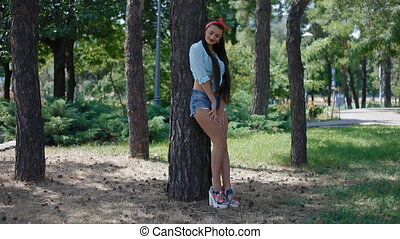 Young american woman pose to photographer outdoor