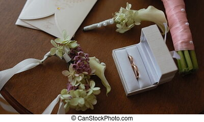 Wedding details on the small table. Cute rings, invitation...