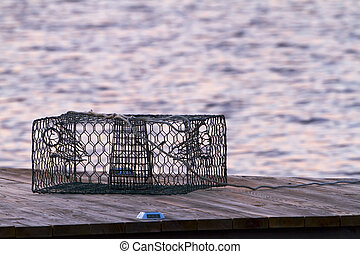 Crab Pot - A crab pot sits on a pier in the early morning...