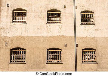 Jail wall with windows with bars